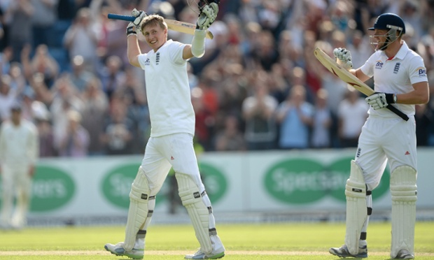 Joe Root celebrates his century with teammates Jonathan Bairstow.