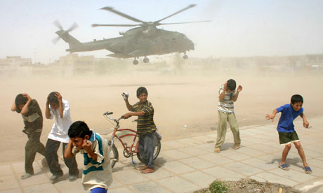 Iraqi children take cover from sand in Basra 2