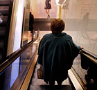 Woman on escalator in Marks and Spencer
