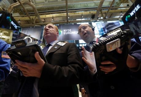Traders Dan Ryan, left, and Gordon Charlop work on the floor of the New York Stock Exchange Tuesday, May 28, 2013