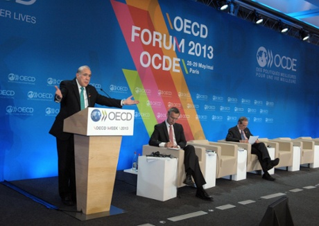 OECD Secretary General Angel Gurria (left) talks as Norway Prime Minister Jens Stoltenberg (C) and OECD Chief Economist Pier Carlo Padoan listen during the presentation of the Economic Outlook during the OECD Week at the OECD headquarters in Paris on May 29, 2013.