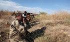 Free Syrian Army rebels fire machine gun rounds at regime positions near al-Nairab airport in Aleppo