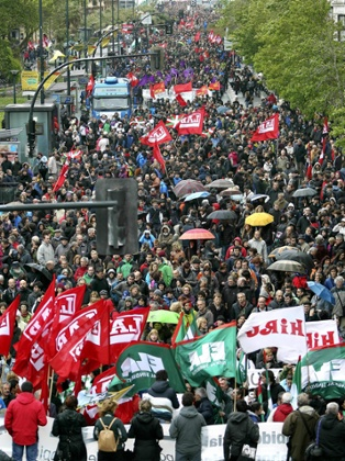 Thousands of people take part in a protest during a 24-hour general strike called by the major Basque unions in protest against the spending cuts approved by the Spanish and Basque governments, in San Sebastian, the Basque Country, Spain, 30 May 2013.