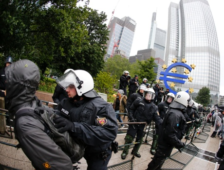 German police officers takes away a demonstrator during a demonstration of some hundred anti-capitalism Blockupy protesters in front of the European Central Bank in Frankfurt, Friday, May 31, 2013.