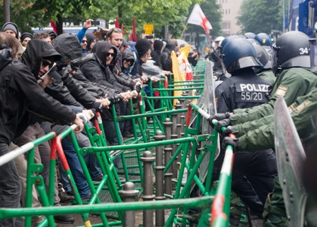 Members of the Blockupy movement fight the police in the inner city of Frankfurt/Main, Germany, 31 May 2013.