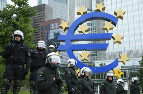 Riot police stand outside the headquarters of the European Central Bank (ECB) during Blockupy protests on May 31, 2013 in Frankfurt am Main, Germany.