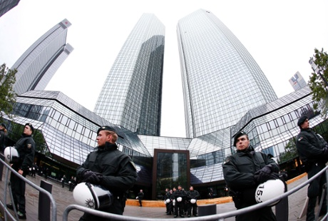German police officers guard the Deutsche Bank building during a demonstration of some hundred anit-capitalism Blockupy protesters in front of the European Central Bank in Frankfurt, Friday, May 31, 2013.