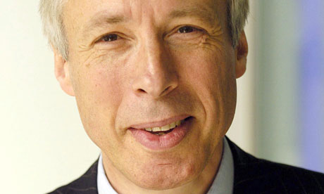Head and shoulders shot of health minister Earl Howe smiling in dark suit and smart shirt