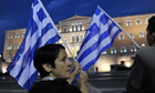 Anti-austerity protesters hold Greek flags in front of parliament in Athens last year