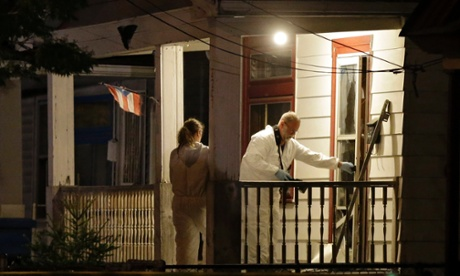 Investigators enter a house on the west side of Cleveland, Ohio, where police say three women were found.