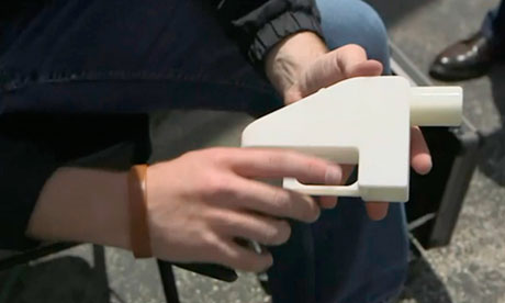 Screengrab of Cody Wilson holding a gun made by 3D printer in Austin, Texas