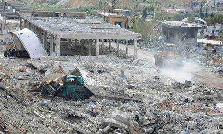 Handout photo showing damage what appears a chicken farm following an air strike near Damascus