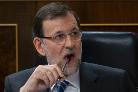 Spain's Prime Minister Mariano Rajoy listens to a debate in the Spanish parliament in Madrid, Wednesday May 8, 2013.