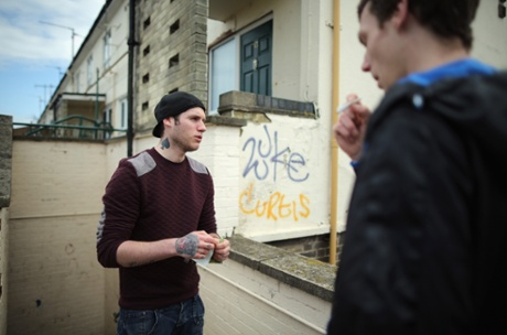 Unemployed brothers Andrew (L) and Jonathan Courtman smoke during the day in Corby Town Centre on April 24, 2013 in Corby, England. A recent study pin pointed Corby as Britain's youth unemployment capital.