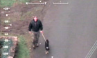 Surveillance footage of Mark Bridger with a dog during the search for April Jones
