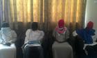 Members of the Boko Haram splinter group attend a media conference in Maiduguri