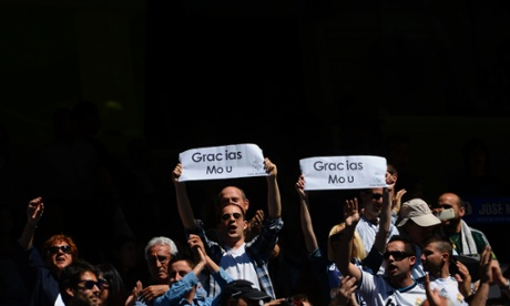 Fans of Real Madrid display placards reading