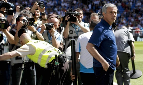 Photographers crowd around José Mourinho at the start of his final match as Real Madrid's coach, against Osasuna.