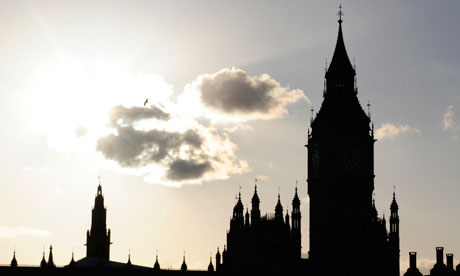 The sun sets behind Britain's House of Commons and Big Ben
