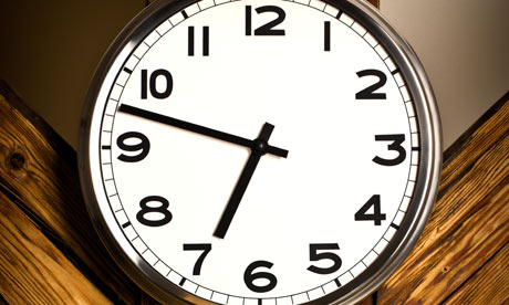 A wall clock hanging on wooden construction