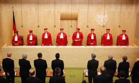 The President of the German Constitutional Court (Bundesverfassungsgericht ) Andreas Vosskuhle (4th R) with the other judges of the second senate as he announces a ruling at the court in Karlsruhe September 12, 2012.
