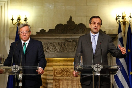 Greek Prime Minister Antonis Samaras (R) and Luxembourg's Prime Minister Jean-Claude Juncker (L) address journalists during a joint press conference in Athens.