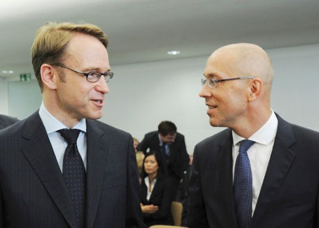 Bundesbank chief Jens Weidmann and ECB Board member Joerg Asmussen (R) wait for the start of the hearing at the Constitutional Court in Karlsruhe, June 11, 2013.