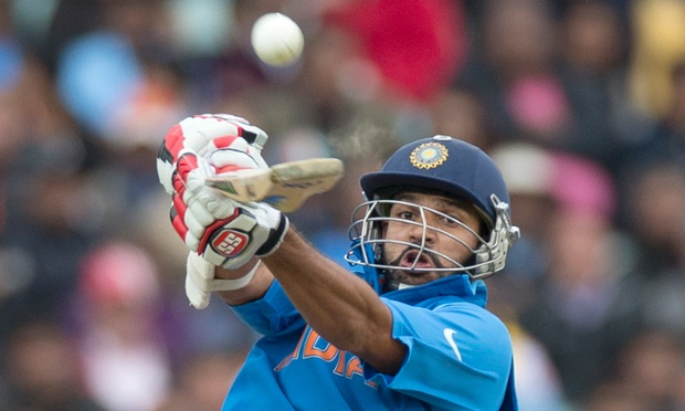 India's Shikhar Dhawan hits a shot during the Champions Trophy match against West Indies at The Oval.