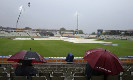Covers on the pitch as rain delays play during the Champions Trophy match between Australia and New Zealand at Edgbaston.