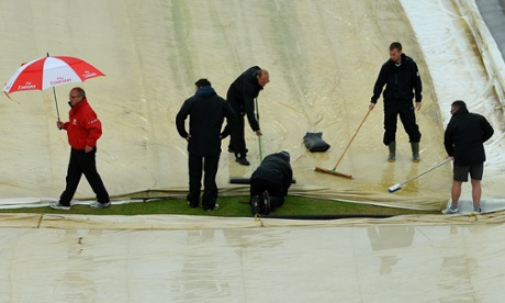 Groundstaff mop up rain during during the Champions Trophy match between Australia and New Zealand at Edgbaston.