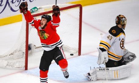 Chicago Blackhawks' Andrew Shaw celebrates scoring in triple-overtime on Boston Bruins goalie Tuukka Rask