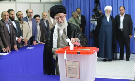 Iran's Supreme Leader Ayatollah Ali Khamenei casts his ballot at his office during the Iranian presidential election in central Tehran.