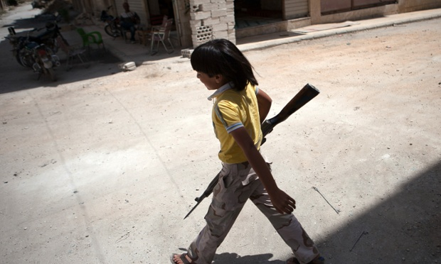 Syrian young boy holds rifle in Maaret al-Numan in the Idlib province of Syria