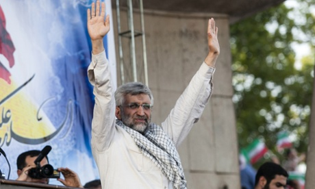 Saeed Jalili waves to his supporters during his campaign rally at Heydarnia stadium in downtown Tehran.