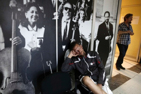 A man sleeps outside a music studio in the Greek state television ERT headquarters in Athens June 14, 2013.