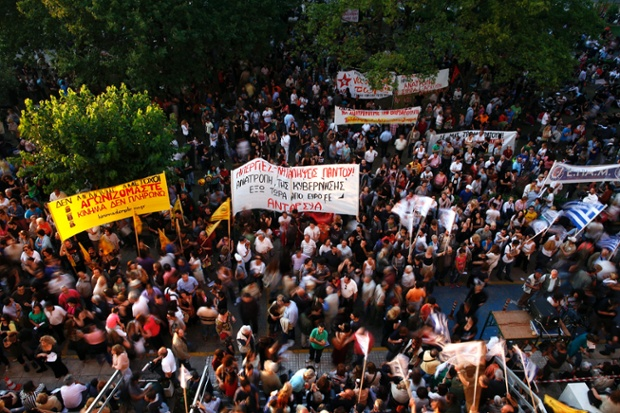 Protesters gathered at the yard of the Greek state television ERT headquarters in Athens.