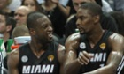 Miami Heat guard Dwyane Wade, left, talks with teammate forward Chris Bosh during the first quarter of Game 4 of the NBA Finals basketball series