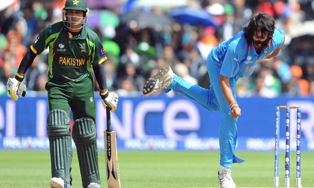 India's Ishant Sharma bowls past Pakistan's Mohammad Hafeez.