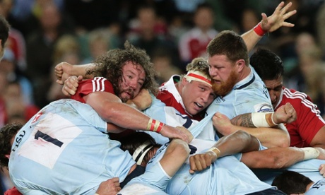Adam Jones and Lions team-mate Tom Youngs hit a wall of Waratahs.