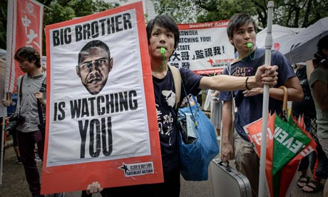 Protesters blow whistles during a protest in support of Edward Snowden in Hong Kong