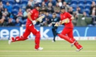 Alastair Cook and Ian Bell cross as play finally gets underway in Cardiff. Bell was later caught by Brendon McCullum.