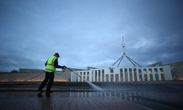 A Parliamentary worker hoses off the bird poo which has accumulated on the forecourt of Parliament House over the weekend. The Global Mail. Mike Bowers.