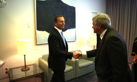 The Leader of the Opposition Tony Abbott meets Dr Brian Schmidt in his Parliament House office. The Global Mail.