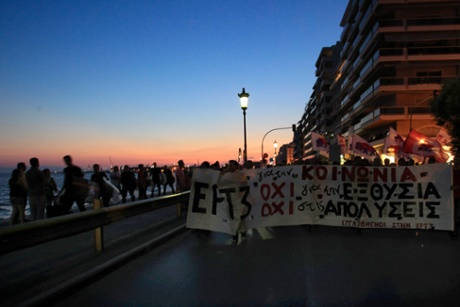 Protesters march during a protest in solidarity to the employees of Greek state broadcaster, ERT, in Thessaloniki, Sunday, June 15, 2013.