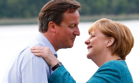 David Cameron welcomes Germany's Chancellor Angela Merkel to the Lough Erne golf resort where the G8 summit is taking place in Enniskillen.