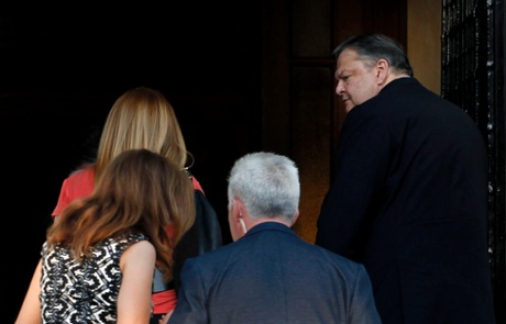 Socialist party leader Evangelos Venizelos, right, arrives the Prime minister's office for a meeting in Athens, on Monday, June 17, 2013.