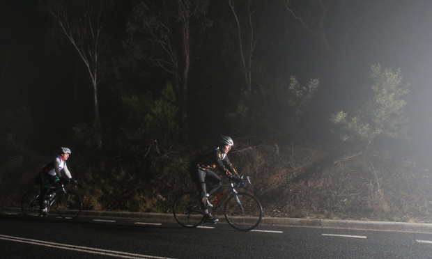 The Leader of the Opposition Tony Abbott rides through a Canberra fog early this morning. The Global Mail.