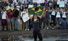 A protester waves the Brazilian flag in a protest in the capital, Brasilia