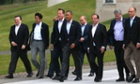 G-8 leaders from left, European Commission President Jose Manuel Barroso, Japan's Prime Minister Shinzo Abe, German Chancellor Angela Merkel, British Prime Minister David Cameron, US President Barack Obama, Russian President Vladimir Putin, French President Francois Hollande, Canadian Prime Minister Stephen Harper and Italian Prime Minister Enrico Letta walk to a group photo opportunity during the G-8 summit at the Lough Erne golf resort i