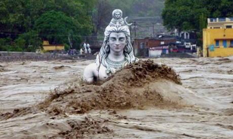 A submerged idol of Hindu Lord Shiva stands in the flooded River Ganges in Rishikesh, in Uttarakhand, India. Monsoon torrential rains have caused havoc leading to flash floods, cloudbursts and landslides as the death toll continues to climb and more than 1,000 pilgrims bound for Himalayan shrines remain stranded.